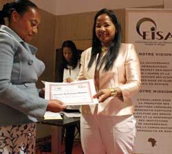 The Women's Caucus President handed assisants their certificates