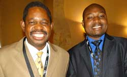 EISA Programme Officer, Ian Goredema  with Cde. Paul Mangwana of ZANU-PF at the symposium