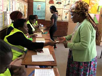 Women vote at a women staffed polling station, 30 July 2018